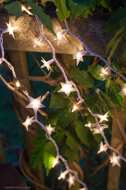 paper foil starry lights (via shelterness)