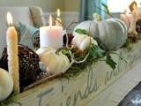 cozy pumpkins and candles centerpiece