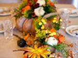 pumpkin planter with flowers centerpiece