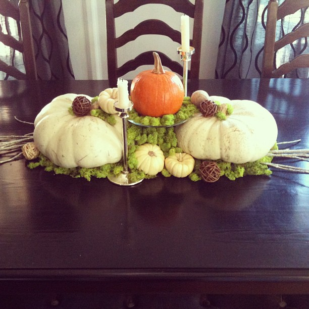white pumpkins and moss centerpiece
