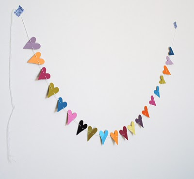 Really Simple DIY Paper Punch Heart Garland (via graceandlightstudio)