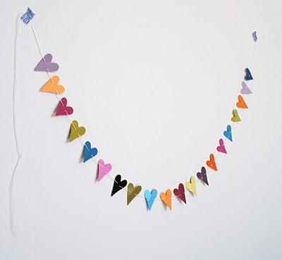 Really Simple DIY Paper Punch Heart Garland (via graceandlightstudio)