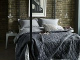 mismatching sheer glass bulbs as hanging lamps for a contemporary meets industrial bedroom