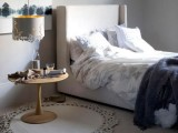 a white laser cut pendant lamp adds a whimsy touch and a chic look to the bedroom