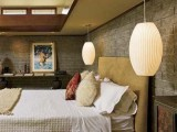 oversized white wicker lamps add a rustic and chic feel to the bedroom and look elegant