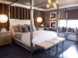 sphere hanging lamps on chains add a rough and wild look to the bedroom, which is done in refined glam style