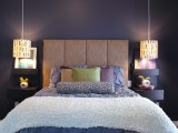 printed round pendant lamps bring much light and contrast the dark bedroom decor