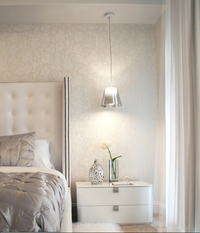 a silver hanging bedside lamp perfectly matches the refined glam interior of the bedroom providing some light