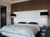 modern square black hanging lamps add chic and a bold touch to the bedroom done in white and brown
