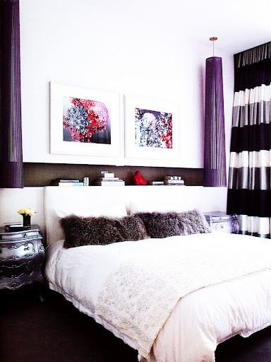 oversized super long purple sconces add color to the monchromatic space and make a statement
