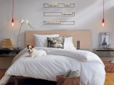 hanging bulbs on red cords will perfectly match a contermporary, Nordic or industrial bedroom