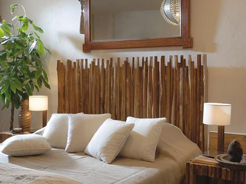Wood sticks is a cheap material for a DIY headboard that looks great!