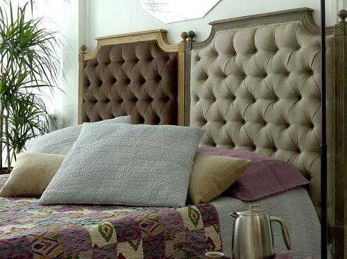 Fabric tufted headboards for him and for her on one king size bed