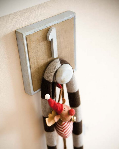 DIY wall hooks  are more than welcome in any kids room.