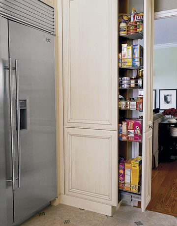 smart pull-out drawer by the fridge that store lots of supplies