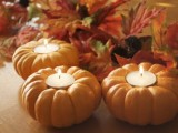 little pumpkin candle holders