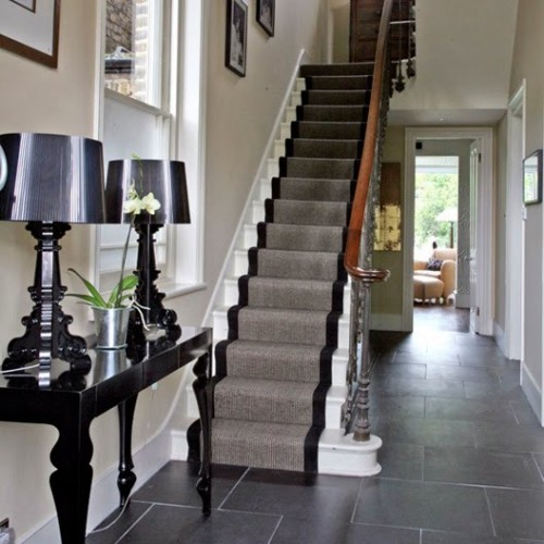 Some people prefer carpet runners that are in contrast with stairs color.