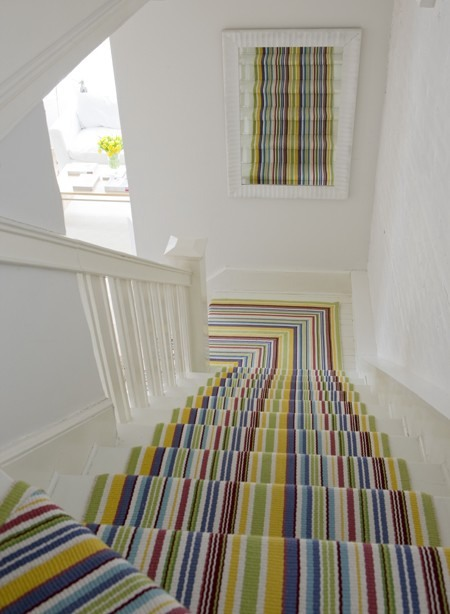 Multicolored stripes would look awesome on any staircase. A mirror could add an illusion that the runner is on a wall too.