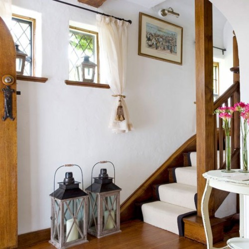 If your walls are painted in light color and stairs in dark you can make them look better with each other with a light colored stair runner.