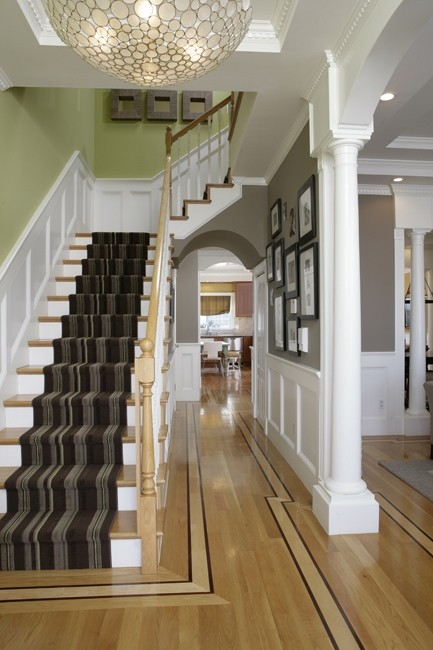 Gray rug runner is always a great choice for stairs. It won't get dirty too quick.