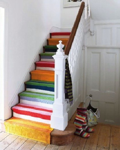 A carpet that is done in many colors would make any stairs a focal point of the hallway.