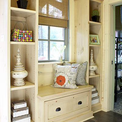 a small windowsill siting space and built-in shelves on both sides of this seat is a cozy nook for reading