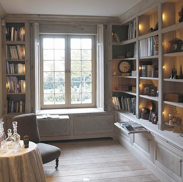 a window seat with no upholstery and bookshelves built all around and next to each seat for a stylish reading nook
