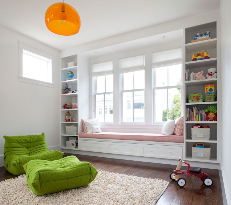 a windowsill reading space with a large daybed with pillows and bookshelves on each side of the bench