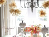 a corn husk pompom garland is a nice rustic idea that won't break the budget and will look veyr fall-like