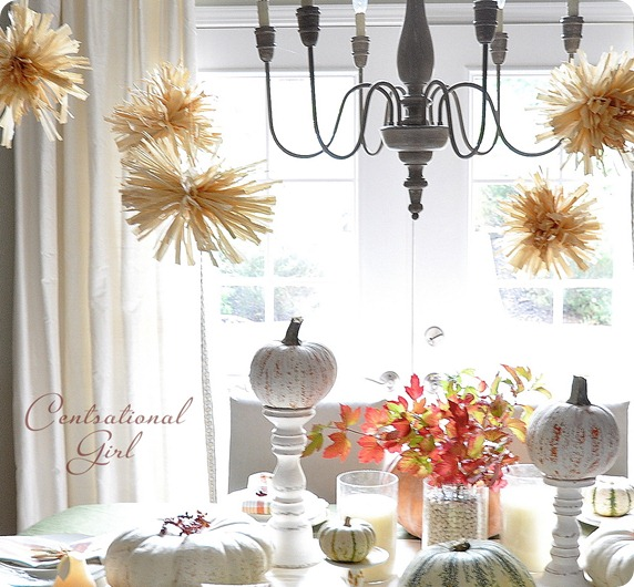 a corn husk pompom garland is a nice rustic idea that won't break the budget and will look veyr fall like