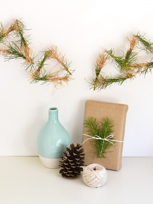 gold dipped pine garland (via makeandtell)