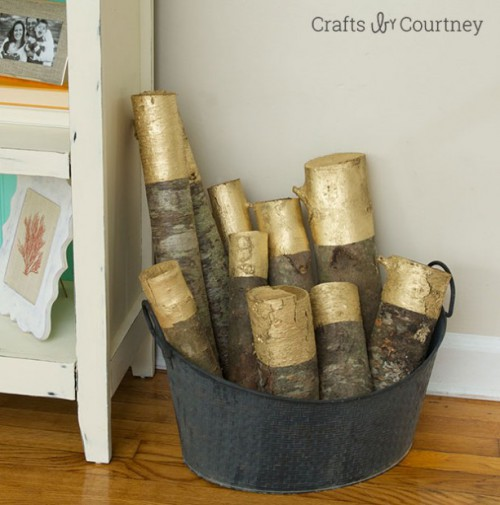 gold painted logs (via shelterness)