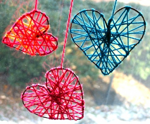 yarn hearts for window decor (via shelterness)
