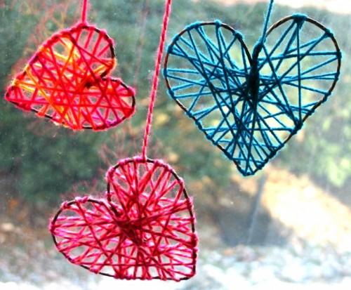 yarn hearts for window decor (via shelterness)