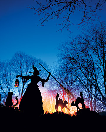 a witch and cats silhouettes and additional lanterns to light them up are chic outdoor Halloween decorations