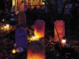 a graveyard with candles and pumpkins is a lovely outdoor decoration to create a mood in the space