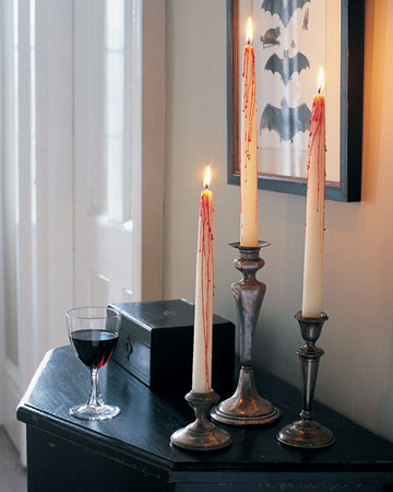 bloody candles in vintage candleholders are stylish and scary Halloween decorations you can easily DIY