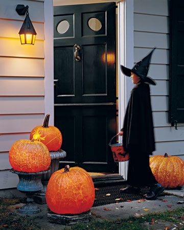 oversized carved pumpkin lanterns are bold decorations that will create a mood both indoors or outdoors