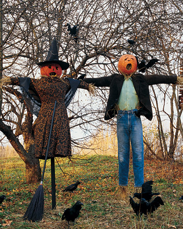 creepy Halloween scarecrows - a man and a woman dressed in usual clothes look weird and scary