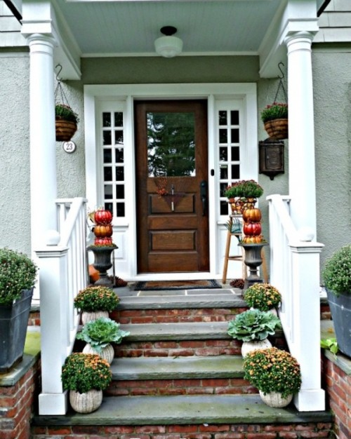 Add a bunch of fall blooms on your front steps. It'd be especially great if you will stuff them into DIY pumpkin planters.