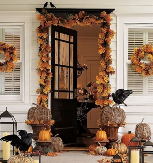 DIY garland made of fallen leaves could be a cool thing to have around your front door. Crow figures would spice things up for Halloween.