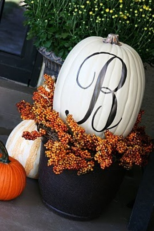 Monoram pumpkin is a great piece of decor for Halloween and for fall in general. To make one you just need some spray paint for a background, transfer paper for a stencil, acrylic paint to fill the stencil and clear spray enamel to protect the pumpkin.