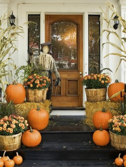 "Scarecrow by the front door is a cute addition to your fall's ""welcome"" display."