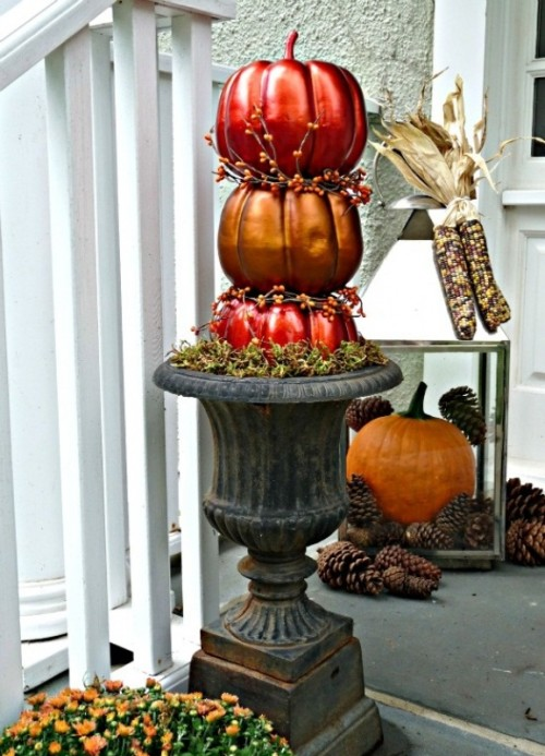 Spray painting with metal paint is a great way to add some shiny glow to your fall's display.