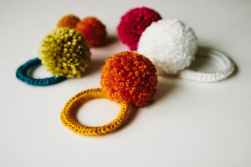 pom pom hair ties (via rebekahgough)