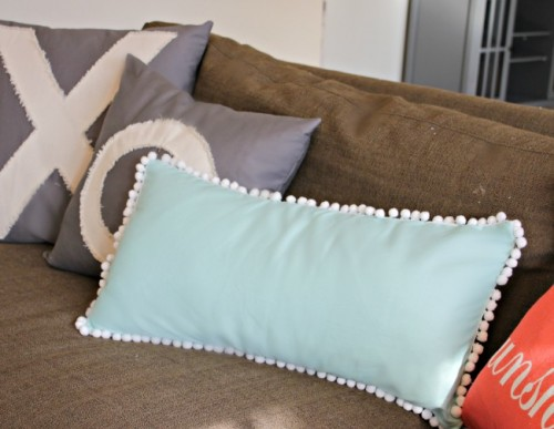 pompom edge pillow