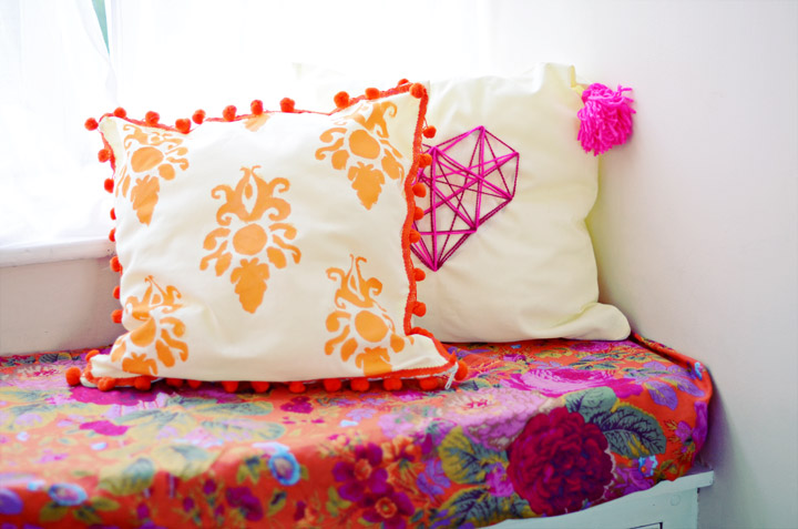 baroque print cushion with pompoms edges