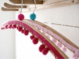 colorful pompom clothes hangers