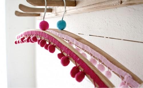 colorful pompom clothes hangers (via shelterness)