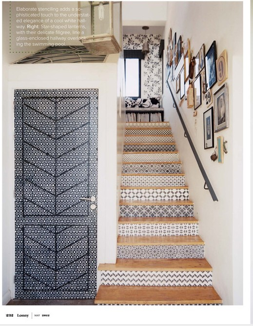 doors with creative grey patterns and matching tiles on the stairs make the space bolder and catchier